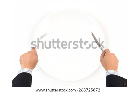 hand hold fork and knife with white plate on white background - stock photo