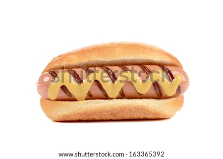 Hand hold hotdog with mustard. Isolated on a white background.