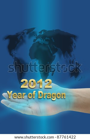 hand hold new year of dragon 2012 with world map - stock photo