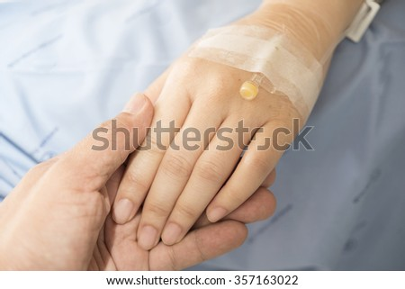 hand hold patient hand - stock photo