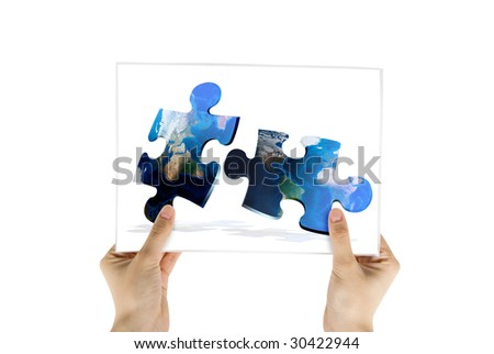 Hand hold photo of global map puzzles communication on white background - stock photo
