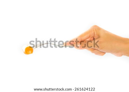 hand hold sausage on a fork. - stock photo