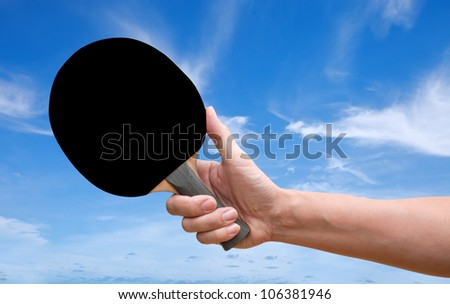 Hand hold Table tennis racket back screen over blue sky - stock photo