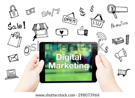Hand hold tablet with digital marketing word on screen with doodle icon on white background. - stock photo