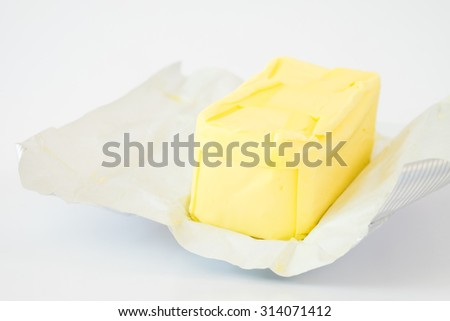 Hand hold the knife cutting the butter - stock photo