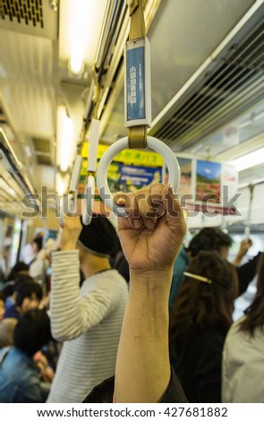 Hand holder or bar inside the high speed train for transportation background in black and white tone with selective focused point - stock photo