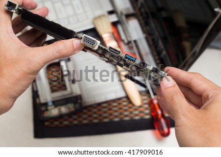 Hand holder Port on motherboard in computer,Repair computer concept. - stock photo