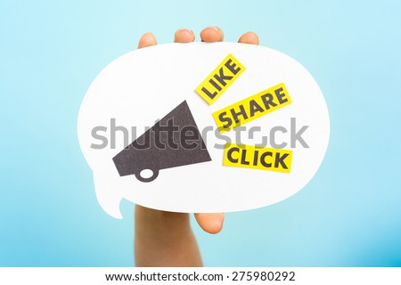 "Hand holding a announce with megaphone and the words ""LIKE"" ""SHARE"" ""CLICK"", on blue background. Social media and internet concept. - stock photo"