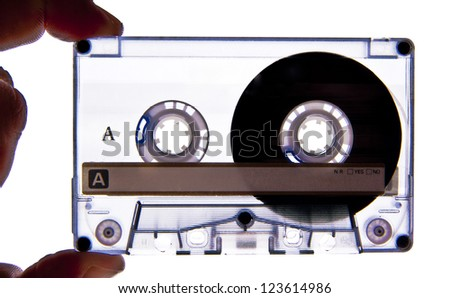 Hand holding a Audio Cassette close up shot - stock photo