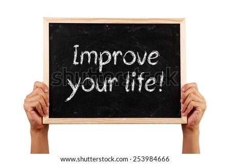Hand holding a black chalkboard which is written text of Improve Your Life. - stock photo