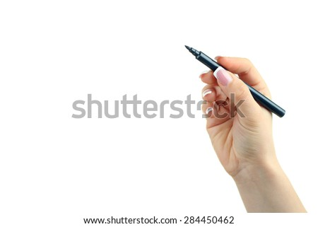 Hand holding a black marker isolated on white background - stock photo