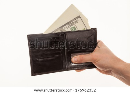 Hand holding a black wallet with money