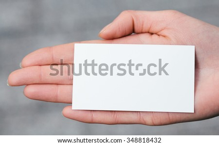 Hand holding a blank business or visit card