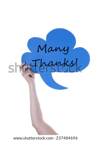 Hand Holding A Blue Speech Balloon Or Speech Bubble With Many Thanks. Isolated Photo - stock photo