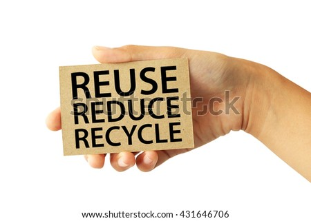 Hand holding a brown recycled paper card with Reuse Reduce Recycle word isolated on white background - stock photo