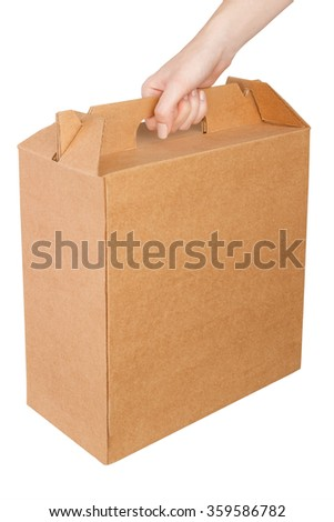Hand holding a cardboard box isolated on white background.  - stock photo