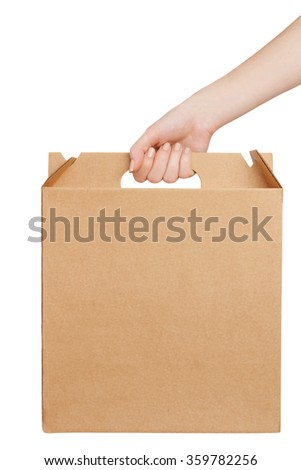 Hand holding a cardboard box isolated on white background with copy space - stock photo