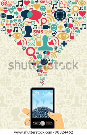 Hand holding a cell phone under social media icons on light background