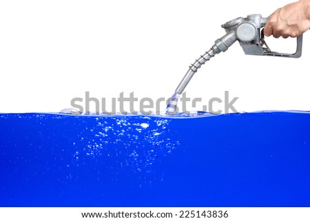 Hand holding a classic fuel nozzle pumping a gasoline fuel dark blue water liquid in a tank of oil Industry isolated on white background with clipping path - stock photo