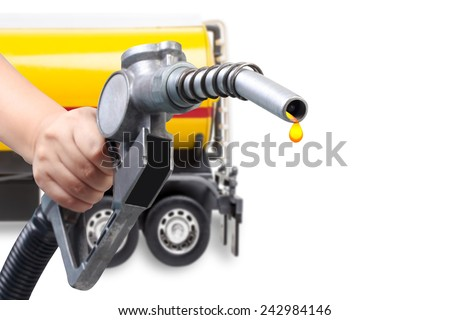 hand holding a classic fuel nozzle pumping and half body of truck with fuel tank isolated on white background with clipping path - stock photo