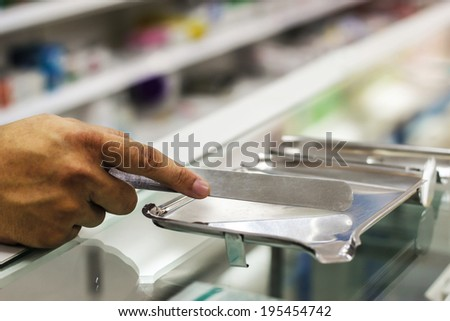 Hand holding a counting tray - stock photo