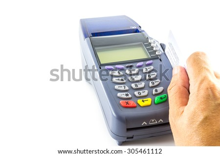 hand holding a credit card with credit card machine isolated on white background