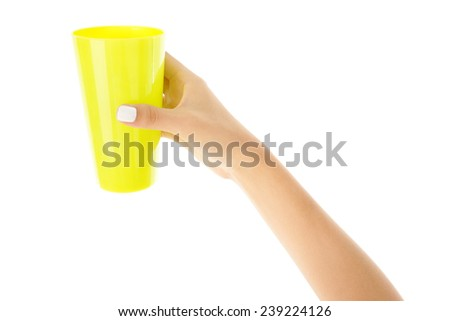 Hand holding a cup, hand close up