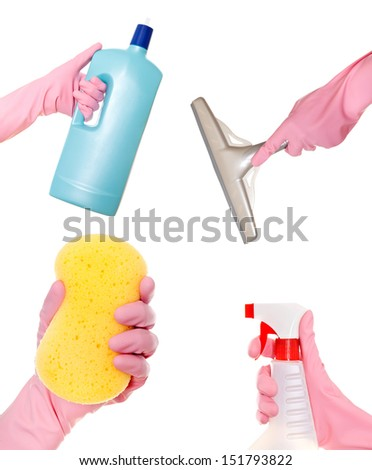 Hand holding a detergent, liquid, squeegee and sponge. Isolated - stock photo