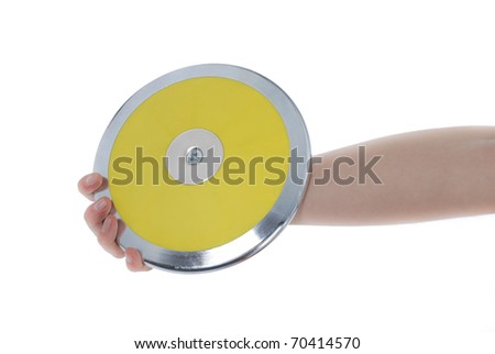 Hand holding a discus on a white background.