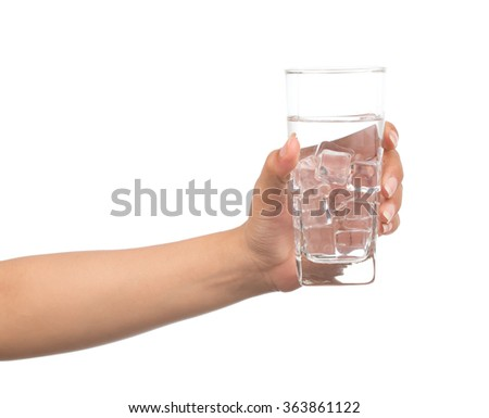 hand holding a Glass of pure water with ice cubes isolated on white background - stock photo