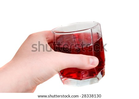 Hand holding a glass with red liquid in it - stock photo