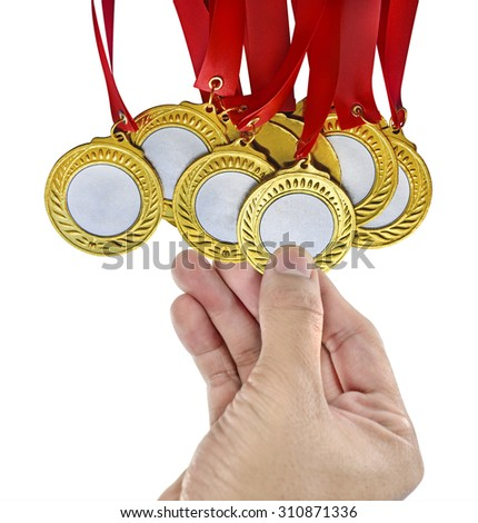 Hand holding a gold medals - stock photo