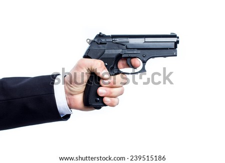 Hand holding a gun isolated on white background - stock photo