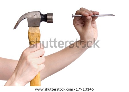 hand holding a hammer and fixing a nail in a white background