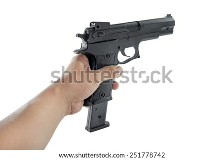 hand holding a handgun changing magazine - stock photo