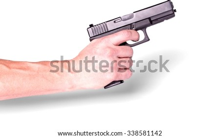 Hand holding a handgun - Isolated