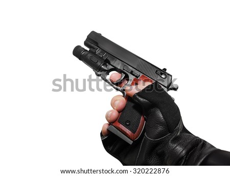 Hand holding a handgun profile view. Isolated first person view hand holding a handgun profile on white background. - stock photo
