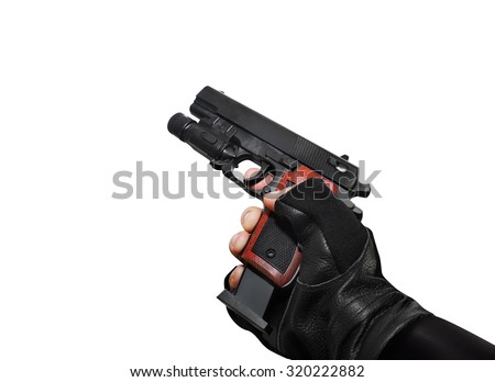 Hand holding a handgun with clip view. Isolated first person view hand holding a handgun with clip on white background. - stock photo