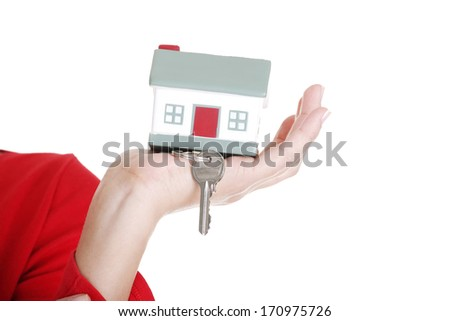 Hand holding a house key. Isolated on white background.  - stock photo