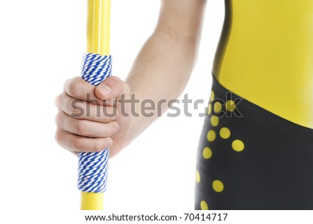 Hand holding a javelin, isolated on a white background. - stock photo