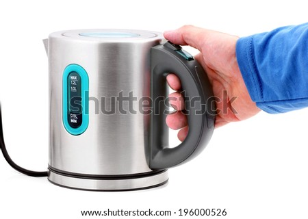 Hand holding a kettle - stock photo
