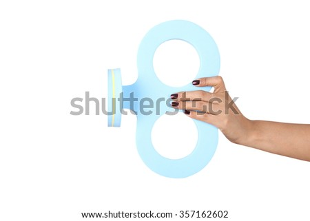hand holding a key winder, isolated on white background