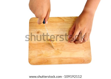 hand holding a knife and wooden chopping board  isolated on White - stock photo