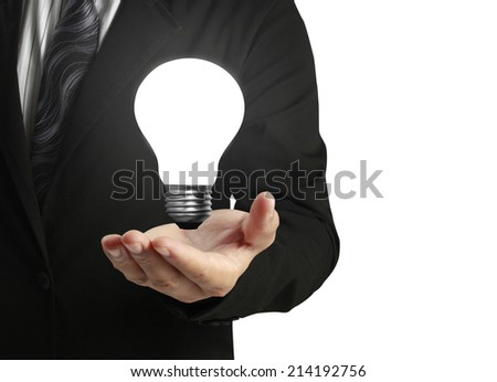 Hand Holding a Light - stock photo