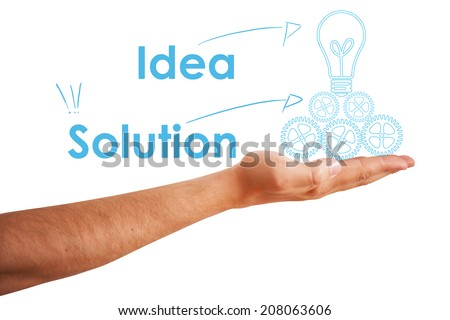 Hand holding a light bulb as a concept for business innovation and success