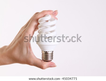 Hand holding a lightbulb on a white background