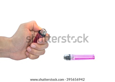 Hand holding a lighter on white background - stock photo