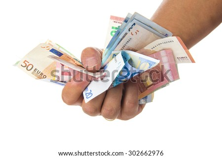 Hand holding a lot of money isolated on a white background - stock photo