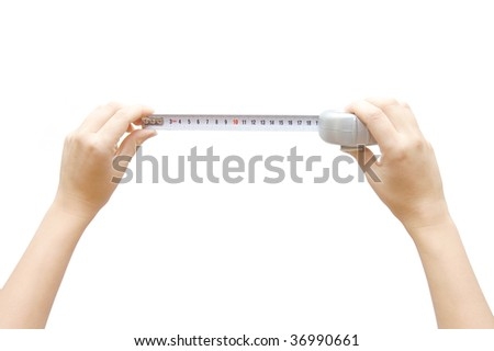 Hand holding a measuring roulette, isolated on white background - stock photo
