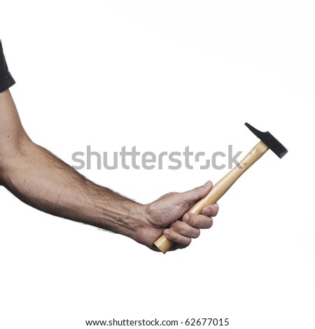Hand holding a medium hammer on a white set - stock photo
